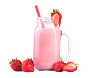 Strawberries milk, on a white background. A glass of strawberry smoothie with red straw. Cocktail from milk and berries. Pink strawberry drink, on a white royalty free stock images