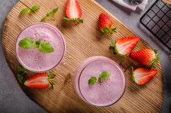 Strawberries milkshake summer drink. Food styled photography Stock Images