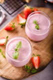 Strawberries milkshake summer drink. Food styled photography Stock Photos