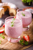 Strawberries milkshake summer drink. Food styled photography Royalty Free Stock Photography