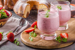 Strawberries milkshake summer drink. Food styled photography Royalty Free Stock Photo