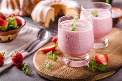 Strawberries milkshake summer drink. Food styled photography Stock Image