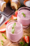 Strawberries milkshake summer drink. Food styled photography Royalty Free Stock Image