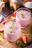 Strawberries milkshake summer drink. Food styled photography Royalty Free Stock Photos