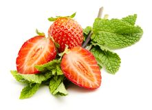 Strawberries with mint leaves Stock Images