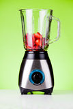 Strawberries In A Mixer. Close up of some fresh fruits in a mixer Stock Image