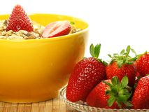 Strawberries and muesli, isolated, closeup Royalty Free Stock Images