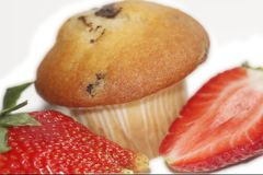 Strawberries with a muffin. Big and clear isolated from the background especially for you. See you Royalty Free Stock Images