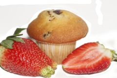 Strawberries with a muffin. Big and clear isolated from the background especially for you. See you Stock Photo
