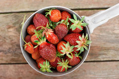 Strawberries in an old metal pot Stock Images
