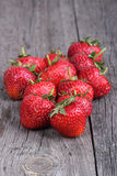 Strawberries on the old wood background Royalty Free Stock Photography