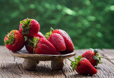 Strawberries on old wooden Stock Photography