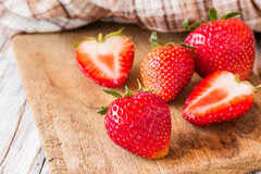 Strawberries on old wooden table background Stock Photo