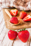 Strawberries on old wooden table background Royalty Free Stock Images