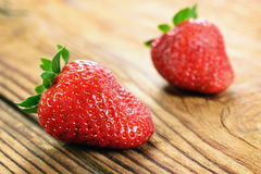 Strawberries on a old wooden table Stock Images