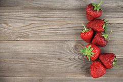 Strawberries On Weathered Wood Royalty Free Stock Images