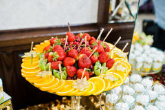 Strawberries with orange and kiwi at wedding reception. Stock Image