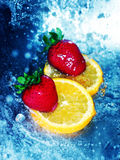 Strawberries on orange slices Stock Images