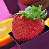 Strawberries and orange slices Royalty Free Stock Image