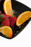 Strawberries and Oranges Royalty Free Stock Photos