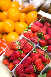 Strawberries and oranges Royalty Free Stock Photo