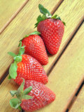 Strawberries and oranges. Cut and ready to eat Royalty Free Stock Images