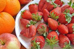 Strawberries and oranges. Cut and ready to eat Royalty Free Stock Photography