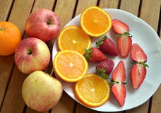 Strawberries and oranges. Cut and ready to eat Royalty Free Stock Photo