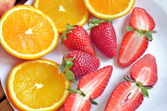 Strawberries and oranges. Cut and ready to eat Stock Image