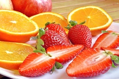 Strawberries and oranges. Cut and ready to eat Stock Photography