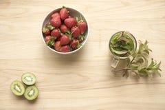 Strawberries, oranges kiwi fruit with mint tea Stock Image