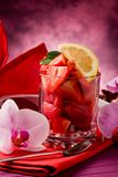 Strawberries with Orchid on red table Royalty Free Stock Photography