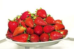 Strawberries on oval bowl Stock Photos