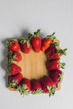 Strawberries over natural wooden background. Top view, copy space Royalty Free Stock Images