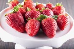 Strawberries over white riser Stock Image