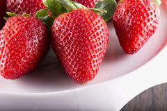 Strawberries over white stand Royalty Free Stock Photos