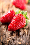 Strawberries over Wood Stock Image