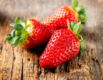 Strawberries over Wood Stock Photography
