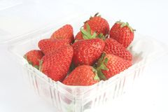 Strawberries Packed in a Plastic Container Stock Photos
