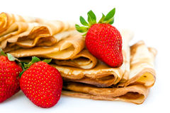 Strawberries and pancakes Stock Photos