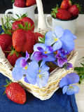 Strawberries and pansies Royalty Free Stock Photo