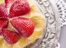 Strawberries on pastry cake in metal plate Royalty Free Stock Photography