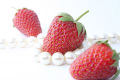 The Strawberries and pearl. Royalty Free Stock Photo
