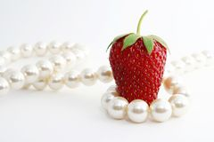 The Strawberries and pearl. Stock Image