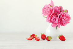 Strawberries and peonies Royalty Free Stock Photo