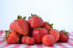 Strawberries. Photograph of some strawberries with a white background Stock Image