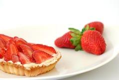 Strawberry Custard Tart. Plate with strawberries and strawberry custard tart pastry Stock Photo
