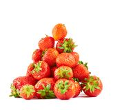 Strawberries pile heap isolated Stock Photos