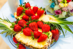 Strawberries on pineapple Royalty Free Stock Image