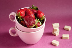 Strawberries in pink cups Royalty Free Stock Photos